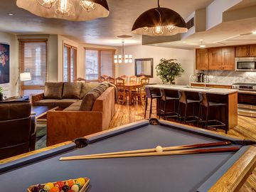 Caledonian condo rental - Pool table with view of kitchen, living room, and private balcony.