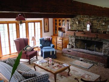 Living room with large stone fireplace