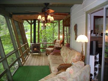 Front screened sleeping porch with gas fireplace