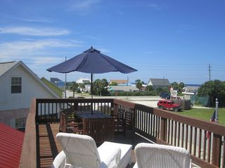 Mexico Beach house photo - Plenty of seating on rooftop deck. Table with 6 chairs and two chaises.