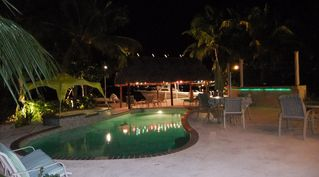 Key Largo house photo - pool deck and Tiki HUt at night