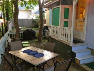 Back patio with outdoor shower and grill. - Oak Bluffs house vacation rental photo