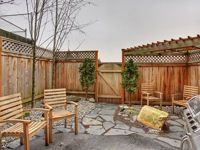 Backyard - Private, landscaped backyard with gas grill.
