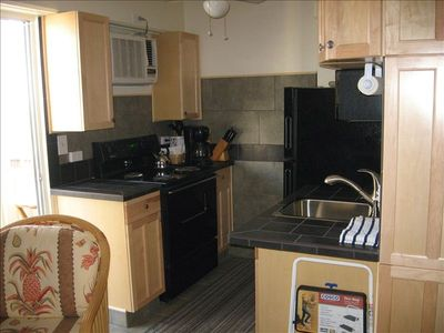Kitchen with full-size range/oven and refridgerator--the comforts of home