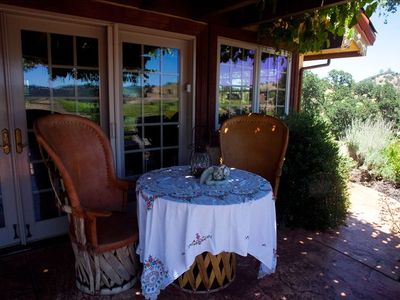 Veranda overlooking vineyards and Lake Melones.