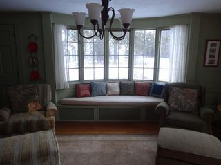 North Conway house photo - Window seat in first living room