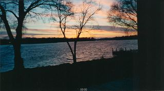 Muskegon house photo - Sunset over Mona lake from back of house.