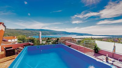 Heated rooftop pool overlooking the sea, jacuzzi, sauna, fitness, children's playground, diving