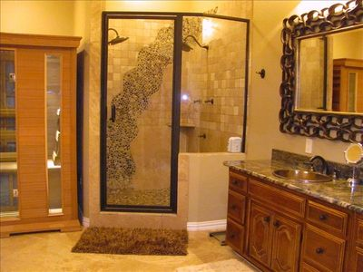 Master bath offers double sinks and sauna, jets in huge shower.