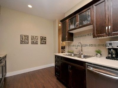 Victoria apartment rental - dishwasher, sink and full cabinets of bar ware and table ware