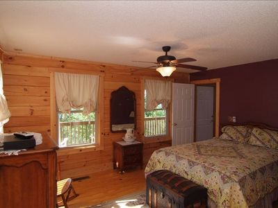Master bedroom with great views. Purple room with master bath.Lg Walk-in closet
