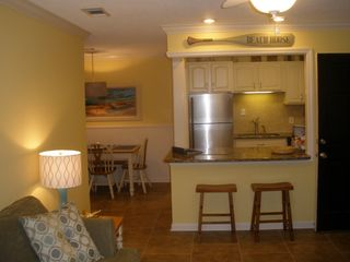 St. Simons Island condo photo - The den and kitchen flow into each other keeping everyone involved in the fun.
