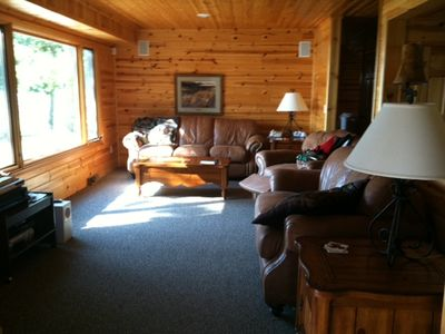 Living room has a gas fireplace and overlooks deck and lake!