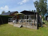 Spacious chalet with modern furnishings. Garden and jetty and lounge bank waterfront