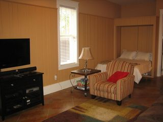 Inlet Beach townhome photo - 1st floor living room w/queen murphy bed and kitchen