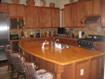 Granite top center island, gourmet kitchen.