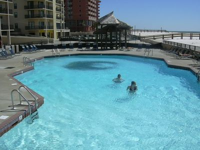 Large pool, Hot tub, splash pad and BBQ's right on the beach.