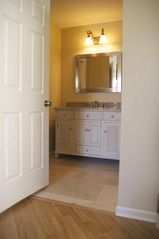 Mesa condo photo - Master vanity and dressing area with walk-in closet to the right.
