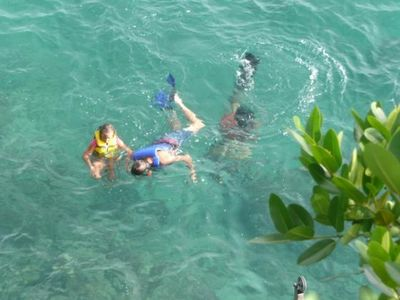 Snorkling in gorgeous multicolored crystal clear Carribean sea at Castles.