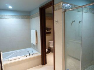 Rio Grande apartment photo - Master bath has a tub, shower with glass doors and private toilet/bidet area.