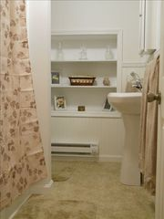 Lancaster apartment photo - Past the log-room den is a completely new bathroom with recessed shelves.