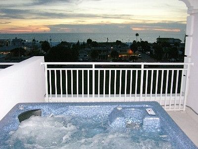 Private rooftop terrace with hot tub and spectacular ocean view.