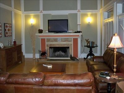 Large great room w/ wood-burn fireplace, leather couches, bar and covered porch!