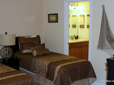 Bedroom with full size and twin size beds