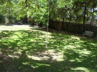 Tybee Island house photo - Large yard with a rope swing hanging from a beautiful large Live Oak tree.