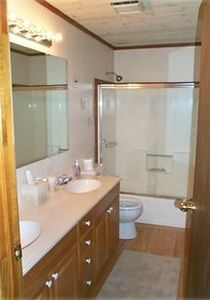 The downstairs bathroom has a full bath and shower