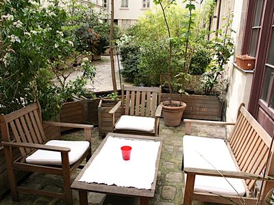 3rd Arrondissement Le Marais apartment rental - Private Courtyard for Apartment - Yes, you get your own private area to visit with friends in the courtyard just below the unit. You will be able enjoy drinks, or even smoke since all CobbleStay apartments are strictly non smoking.