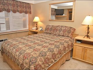 Steamboat Springs condo photo - Queen Bedroom with HDTV, visible in mirror reflection