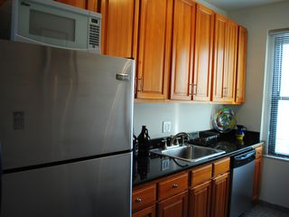 Queens apartment photo - New appliances, stainless steel fridge, stove, dishwasher.