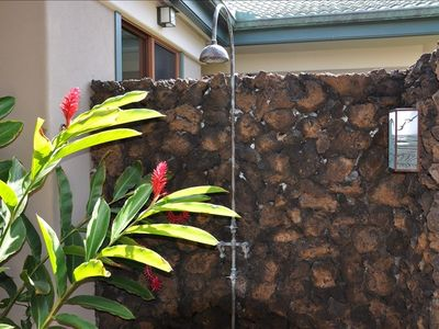 Escape to your own bathing garden in a lava rock-encased outdoor shower
