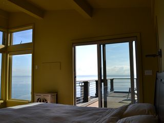 Bainbridge Island house photo - master bedroom. Jøtul stove warms by night. Sunrise over the Sound.