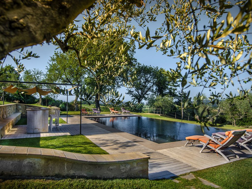 The villa and pool offer breathtaking views of sight