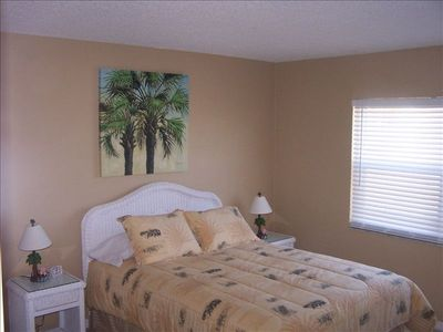 guest bedroom lower level, queen size bed large closet and tv