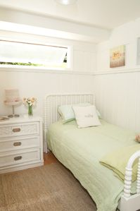 Cottage style chic - one of the five bedrooms in summer