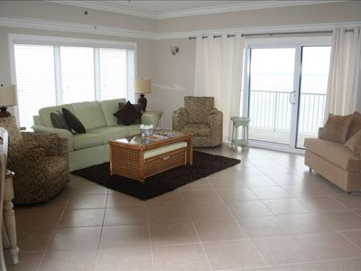 The living room has plenty of seating area for relaxing.  The sofa is a pull out