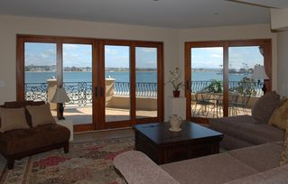 Mission Beach condo photo - Living room with expansive view of beach and Sail Bay.