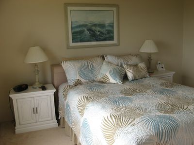 Ormond Beach condo rental - Master bedroom with queen bed, attached bath, 2 ocean view windows and TV