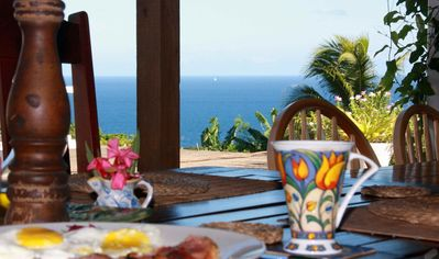 Ham and eggs with Caribbean panorama