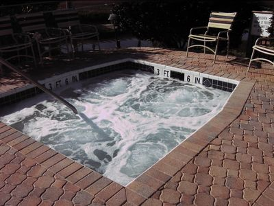 Jacuzzi adjoins heated pool