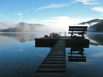 Misty morning view of lake and dock from stone steps
