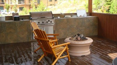 Gather around the gas fire pit on the deck.