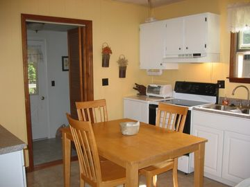 Kitchen with full amenities in the Woodrow