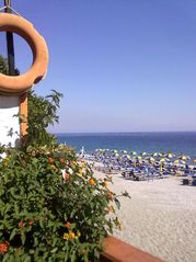Reggio Calabria City villa photo - beach in the summer period, with umbrella on the beach