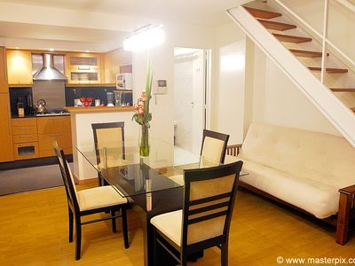 Recoleta apartment rental - Dining room with 4 chairs and Queen size futon under stairs that opens up.