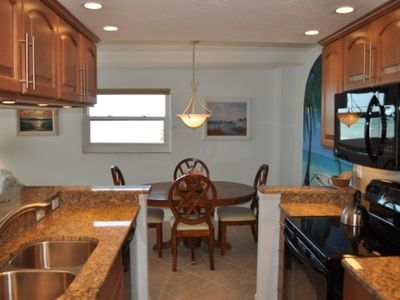 upgraded open kitchen with granite counters and new appliances in 2011