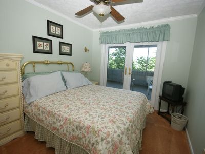 Queen bedroom with fan-opens to screened porch-has closet and dresser.